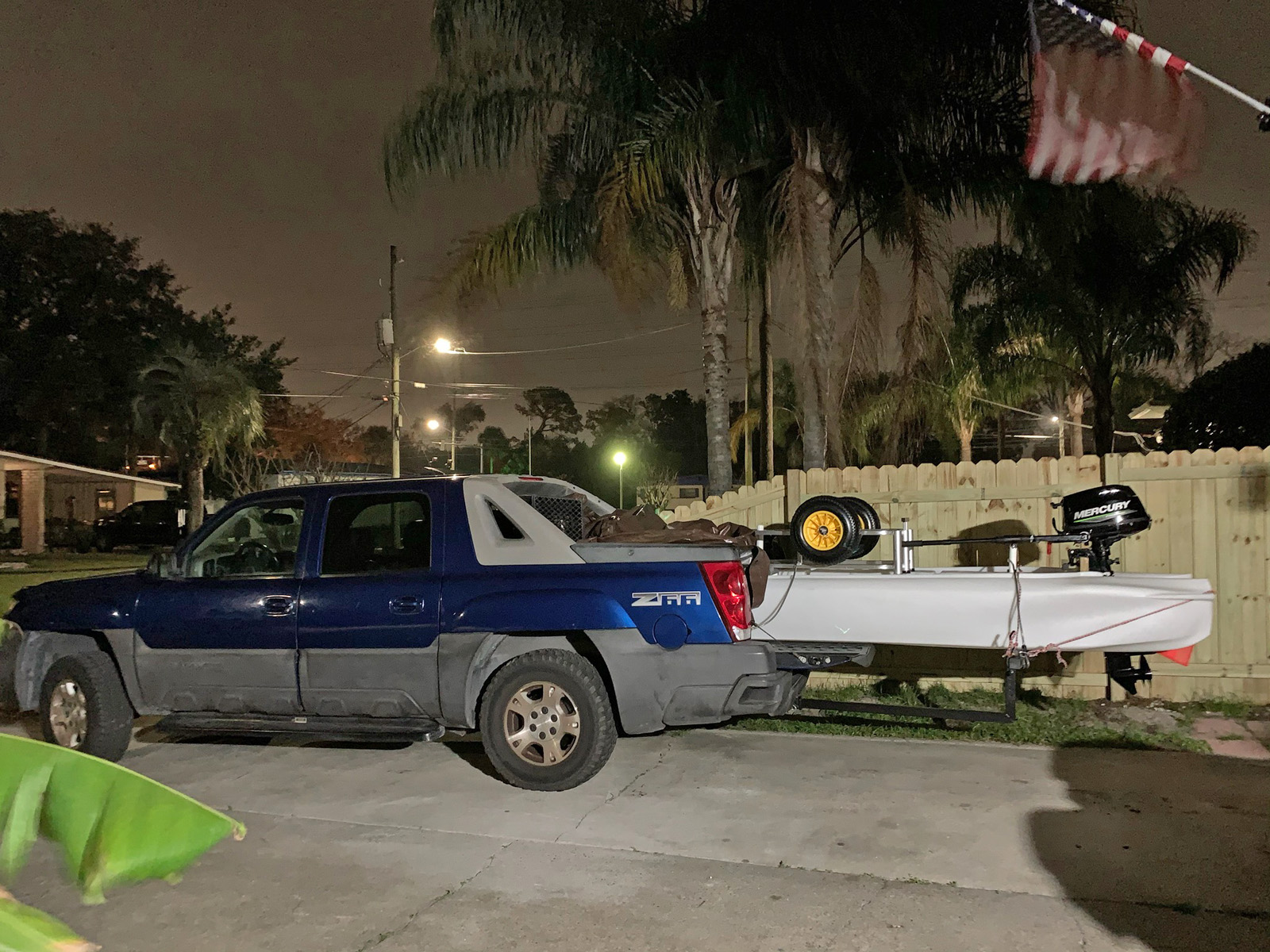 Pickup truck carrying Wavewalk S4 motor kayak skiff