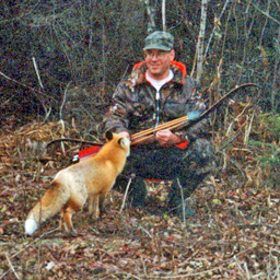 outfitter fisherman with friendly fox